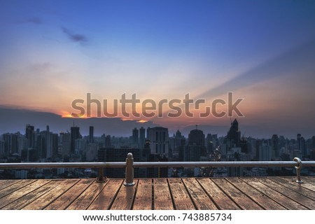 sunset cityscape view on wood perspective balcony - can use to display or montage on product