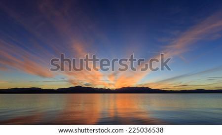 Sunset cloud burn at Lake Tahoe - stock photo
