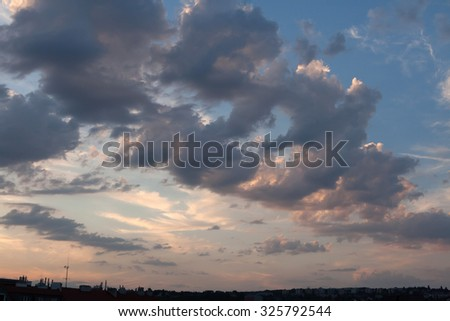 Sunset clouds in Prague, Czech Republic. - stock photo