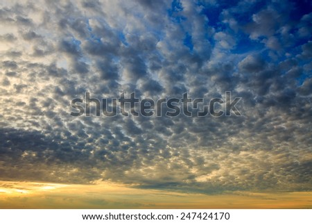 Sunset clouds in the sky - stock photo