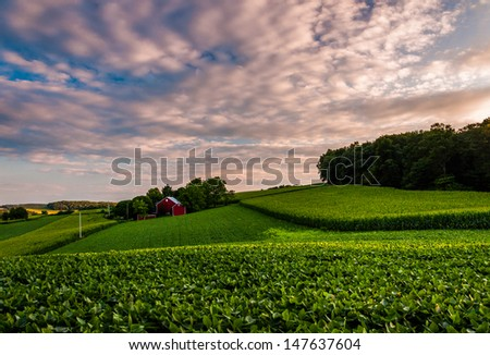Sunset clouds over a farm in Southern York County, Pennsylvania. - stock photo