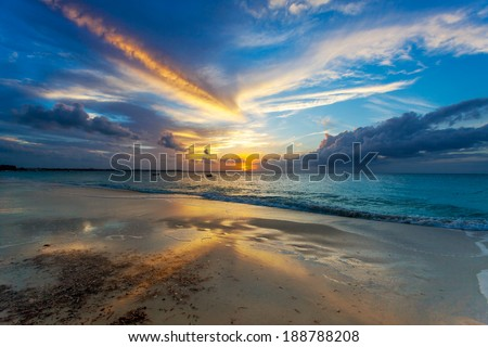 Sunset clouds over Grace Bay Beach (by Park on Princess Drive), Providenciales, Turks and Caicos Islands - stock photo