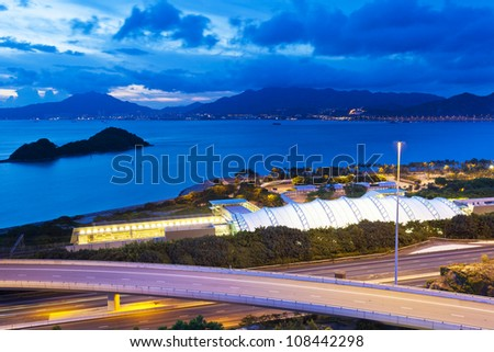 Sunset coast at highway and station - stock photo