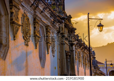 sunset colonial architecture in antigua city guatemala - stock photo