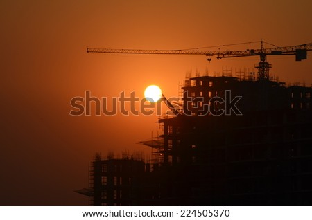 sunset, construction site and colorful sky, end of day - stock photo