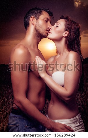 sunset couple sexy kissing love - stock photo