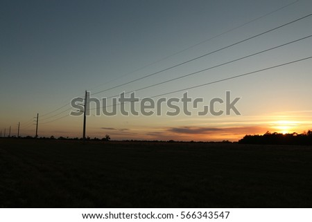 Sunset electric poles