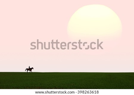 Sunset field landscape with horseback rider on a horizon against the beautiful sky  - stock photo