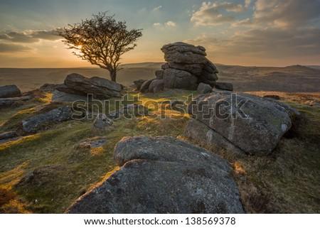 Sunset from Emsworthy Rocks Dartmoor national park Devon Uk - stock photo