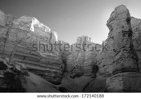 Sunset from inside the Flour Caves in the Negev Desert. The soft, crumbly soil gives the caves the appearance of flour. - stock photo