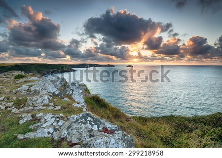 Sunset from the cliffs at Trevan Point above Lundy Bay near Polzeath on the north coast of Cornwall - stock photo