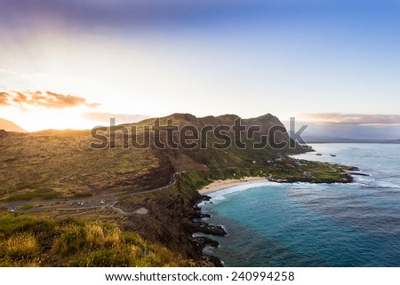 Sunset from the Makapuu Lighthouse elevated lookout, overlooking Oahu's south shore - stock photo