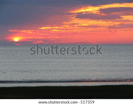 Sunset from the shore, Orleans, MA - stock photo