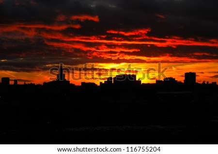Sunset Glow and Silhouetted skyline of Moscow It is the stunning sunset glow of Moscow. The Silhouette of Moscow skyline and skyscrapers are so beautiful. Triumph Palace is is the highest in europe. - stock photo