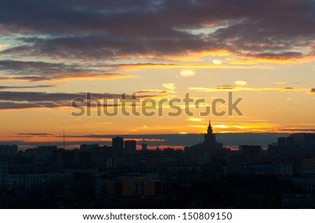 Sunset Glow and  Silhouetted skyline of Moscow-1 It is the stunning sunset glow of Moscow. The Silhouette of Moscow skyline and skyscrapers are so beautiful. Triumph Palace is on the right side. - stock photo