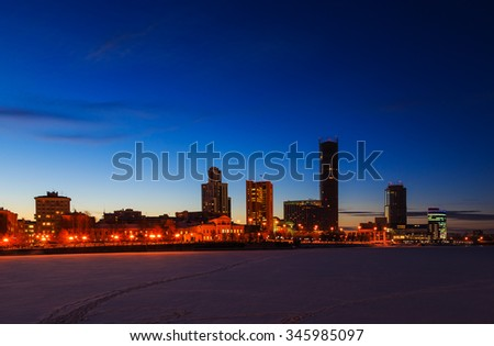sunset glow of the night and in the winter over the center of Yekaterinburg