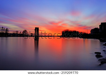 Sunset glow over river with blood red color - stock photo