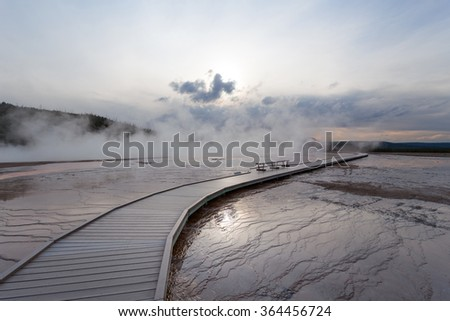 Sunset Grand Prismatic basin, Midway Geyser Basin, Yellowstone National Park, Wyoming USA - stock photo