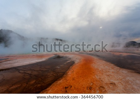 Sunset Grand Prismatic Spring, Midway Geyser Basin, Yellowstone National Park, Wyoming USA - stock photo