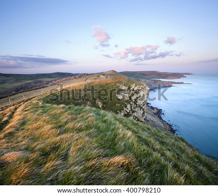 Sunset illuminates the view from Gad Cliff towards Kimmeridge on Dorset's Jurassic Coast - stock photo