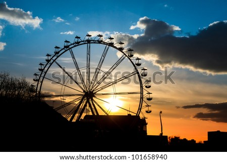 Sunset in amusement park at summer - stock photo