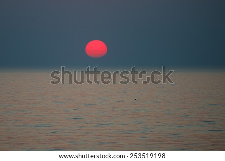 Sunset in Baltic sea in autumn - stock photo