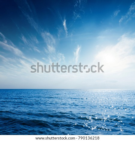 sunset in blue sky over sea