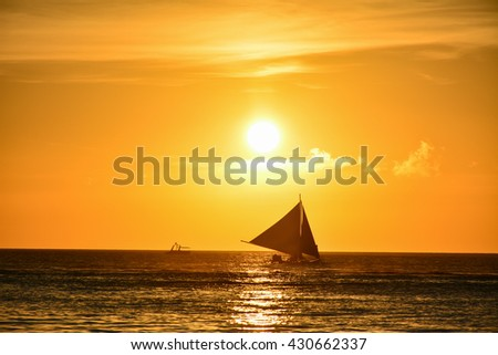 Sunset in Boracay, Philippines with a boat in foreground