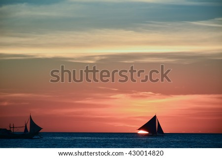 Sunset in Boracay, Philippines with a boat in the foreground