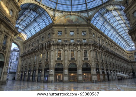 Sunset in famous luxury shopping mall Galleria Vittorio Emanuele in Milan, Italy