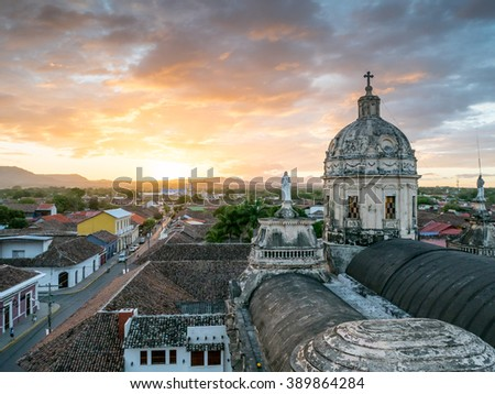 Sunset in Granada with a Church in the background, Nicaragua - stock photo