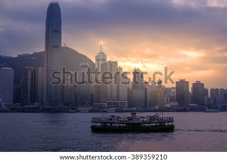 Sunset in Hong Kong harbor - stock photo