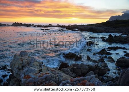 Sunset in idyllic beach of Kleinmond, South Africa - stock photo