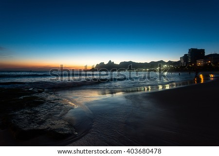 Sunset in Ipanema Beach in Rio de Janeiro, Mountains in the Horizon.