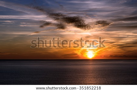 Sunset in Liguria Italy / Beautiful sunset over the sea with cloudy sky. Cinque terre, Liguria, Italy, UNESCO world heritage site - stock photo