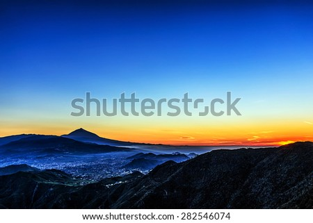 Sunset in mountains and blue sky with fog and Teide volcano on background in Tenerife Canary island, Spain