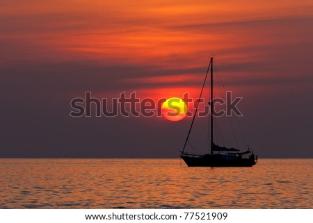 Sunset in Nai Harn beach and sailboat silhouette. Phuket, Thailand. - stock photo