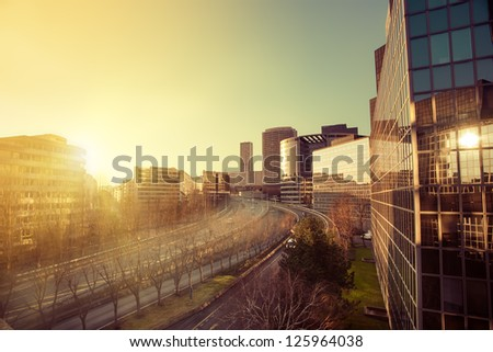 sunset in office buildings in Paris France - stock photo