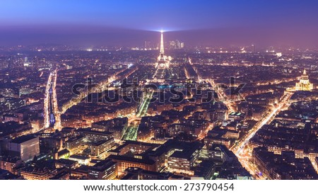 Sunset in Paris, with the Eiffel Tower. - stock photo
