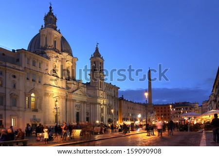 Sunset in Piazza Navona in Rome, Italy with the church of Sant'Agnese in Agone and the Obelisk of the Fontana dei Quattro Fiumi (the Fountain of the 4 Rivers) by Bernini. - stock photo