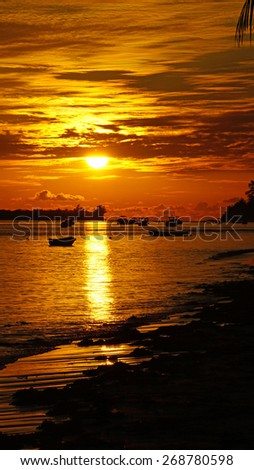 sunset in red and orange on tropical beach