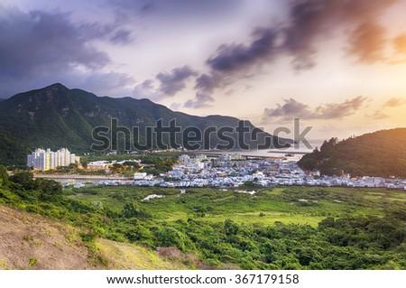 Sunset in Tai O fishing village, Hong Kong - stock photo