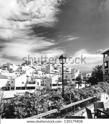 Sunset in Tenerife island, Spain. Tourist hotel Resort. Vintage black and white - stock photo