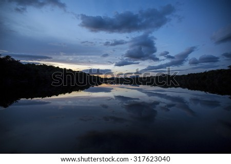 Sunset in the Canaima National Park and reflections in the water of the Gauja river. Bolivar State, Venezuela 2015 - stock photo