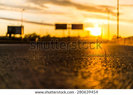 Sunset in the city. View from the road level - stock photo