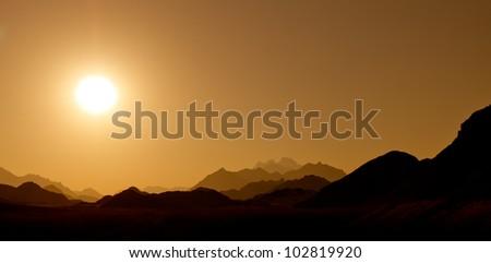 Sunset in the desert mountains - stock photo