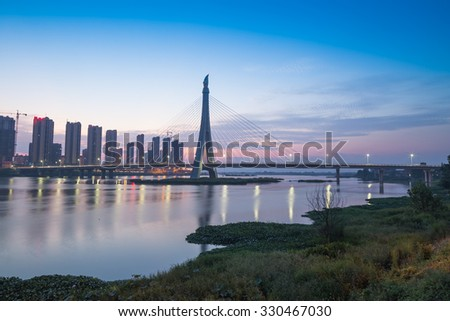 sunset in the Fuzhou city before the Gandong bridge in the Fu river - stock photo
