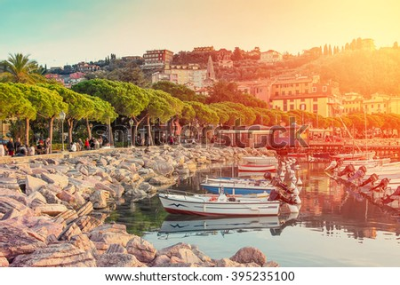 Sunset in the harbor in small sea town of Lerici, Italy. - stock photo