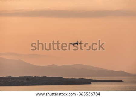 Sunset in the Heraklion airport. Landing of the airplane. - stock photo