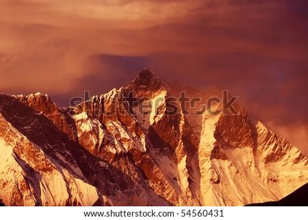 Sunset in the Himalayas, Lhotse Ridge, Nepal, Everest Region - stock photo